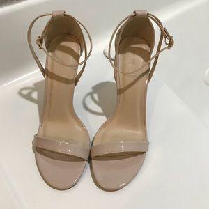 Never worn-nude heel size 7-1/2